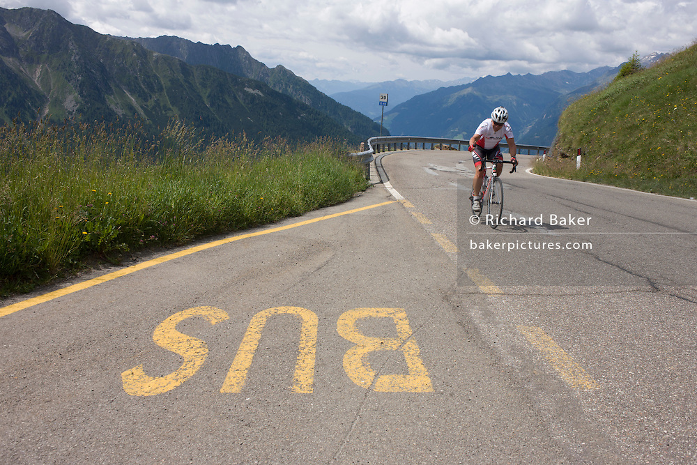 A lone rider nears the top of the Jaufenpass, the highest point at 2,094 metres on the road between Meran-merano and Sterzing-Vipiteno in South Tyrol, Italy. The South Tyrolean budget is 5bn Euros with only 10% leaving the region for government in Rome.