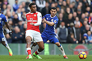 Alex Iwobi of Arsenal and Pedro of Chelsea in action. Premier league match, Chelsea v Arsenal at Stamford Bridge in London on Saturday 4th February 2017.<br /> pic by John Patrick Fletcher, Andrew Orchard sports photography.