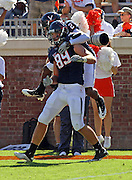 Oct 2, 2010; Charlottesville, VA, USA; Virginia Cavaliers wide receiver Jared Green (2) celebrates the touchdown of teammate Virginia Cavaliers tight end Colter Phillips (89) during the game against the Florida State Seminoles at Scott Stadium. Florida State won 34-14.  Mandatory Credit: Andrew Shurtleff-