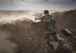 October 21, 2016 - Tel Kaif, Iraq - A Peshmerga sniper takes aim and shoots during a military operation. Peshmerga forces are engaging in an operation to attack Islamic State militants in Mosul. (Credit Image: © Bertalan Feher via ZUMA Wire)