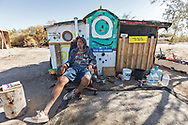 """""""Tall"""" Paul Holman III at his Slab City campsite.<br /> Slab City and the local environs."""