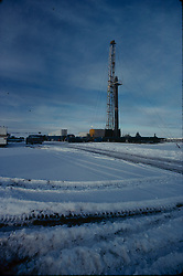 Stock photo of an on-shore rig in a snowy work site