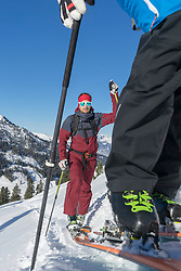 Skiers climbing up on snowy mountain