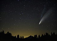 C/2020 F3 (NEOWISE) or Comet NEOWISE is a retrograde comet with a near-parabolic orbit discovered on March 27, 2020, by astronomers using the NEOWISE space telescope. At that time, it was a 10th-magnitude comet, located 2 AU (300 million km; 190 million mi) away from the Sun and 1.7 AU (250 million km; 160 million mi) away from Earth.[3]<br /> <br /> By July 2020, it was bright enough to be visible to the naked eye. It is one of the brightest comets in the northern hemisphere since Comet Hale–Bopp in 1997. Under dark skies, it can be clearly seen with the naked eye[4] and might remain visible to the naked eye throughout most of July 2020.[3] Until July 23, as the comet gets further from the Sun it will be getting closer to Earth. As of July 16, the comet is about magnitude 2.<br /> <br /> Seen from Indian Ford Meadow, near Sisters, Oregon. the land is under conservation by the Deschutes Land Trust. <br /> <br /> Mt Jefferson, the second highest peak in the state is seen at the bottom of the image.