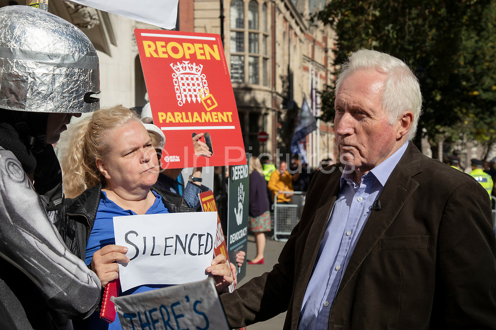 Television presenter and broadcaster David Dimbleby speaks to pro-remain protesters outside The Supreme Court as the first day of the hearing to rule on the legality of suspending or proroguing Parliament begins on September 17th 2019 in London, United Kingdom. The ruling will be made by 11 judges in the coming days to determine if the action of Prime Minister Boris Johnson to suspend parliament and his advice to do so given to the Queen was unlawful. David Dimbleby is a British journalist and former presenter of current affairs and political programmes, now best known for the BBC's long-running topical debate programme Question Time. (photo by Mike Kemp/In Pictures via Getty Images)