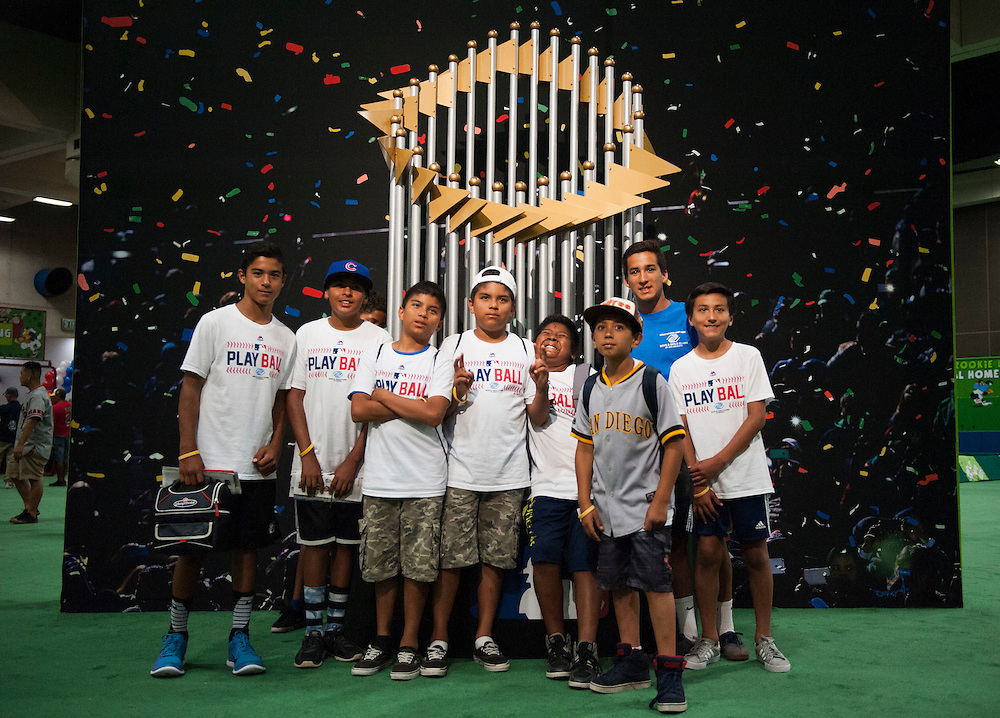 Kids from the Boys and Girls Club of San Dieguito pose for a photo next to a larger-than-life replica of the World Series Championship trophy during the 2016 MLB All-Star FanFest at the San Diego Convention Center on Friday.<br /> <br /> ///ADDITIONAL INFO:   <br /> <br /> Fanfest.0709.kjs  ---  Photo by KEVIN SULLIVAN / Orange County Register  -- 7/8/16<br /> <br /> The 2016 MLB All-Star game Fan Fest at Petco Park and the San Diego Convention Center.