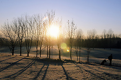 © Licensed to London News Pictures. 17/01/2013.The UK has woken up this morning to freezing temperatures as the cold weather continues today (17.01.13).The sunrise at Cray Valley Golf Club in Orpington,Kent as an early morning golfer heading out for a round..Photo credit : Grant Falvey/LNP
