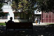 Students socialize outside Hugh Gillis Hall during the first day of classes at San Jose State University in San Jose, California, on August 25, 2014. (Stan Olszewski/SOSKIphoto)