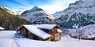 Mountain chalet in winter looking towards the Jungfrau mountain. Grindelwald, Swiss Alps .<br /> <br /> Visit our SWITZERLAND  & ALPS PHOTO COLLECTIONS for more  photos  to browse of  download or buy as prints https://funkystock.photoshelter.com/gallery-collection/Pictures-Images-of-Switzerland-Photos-of-Swiss-Alps-Landmark-Sites/C0000DPgRJMSrQ3U