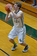 North Ridgeville at Elyria Catholic boys varsity basketball on February 10, 2015. Images copyright © David Richard and may not be copied, posted, published or printed without permission.