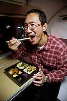 Japanese Man Eating a bento with Chopsticks