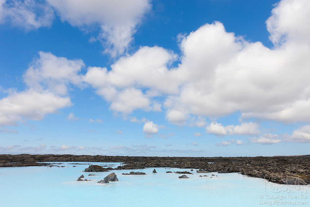 The milky blue water of Iceland's Blue Lagoon (Bláa lónið) somewhat mimicks the color of the summer sky. Portions of the Blue Lagoon are heated with natural, geothermal energy. The mineral-rich hot pools are a popular tourist destination.