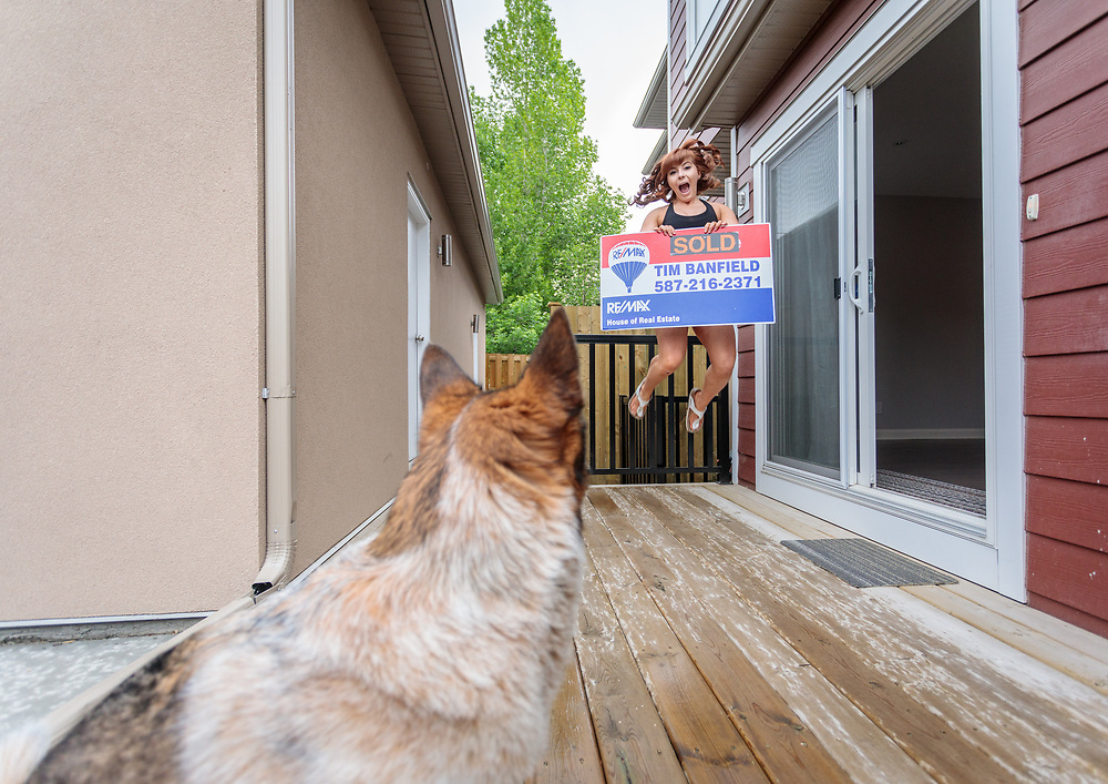 Beth taking possession of her home in Windsor Park, Calgary