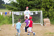 20140601 Free for editorial use image<br /> <br /> Halifax colleagues in Bournemouth are proud to give extra back to their local community by hosting their Big Lunch event on Sunday 01 June 2014.<br /> <br /> Three boys try to beat the goalie during The Big Lunch at the New Leaf Allotment in Bournemouth. <br /> <br /> For more information please contact: Catherine Eastham on 020 3697 4304<br /> <br /> If you require a higher resolution image or you have any other onEdition photographic enquiries, please contact onEdition on 0845 900 2 900 or email info@onEdition.com<br /> This image is copyright the onEdition 2014©.<br /> This image has been supplied by onEdition and must be credited onEdition. The author is asserting his full Moral rights in relation to the publication of this image. Rights for onward transmission of any image or file is not granted or implied. Changing or deleting Copyright information is illegal as specified in the Copyright, Design and Patents Act 1988. If you are in any way unsure of your right to publish this image please contact onEdition on 0845 900 2 900 or email info@onEdition.com