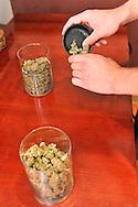 An employee at Alternative Medical Solutions prepares an order of medical marijuana in Aspen, Colorado.