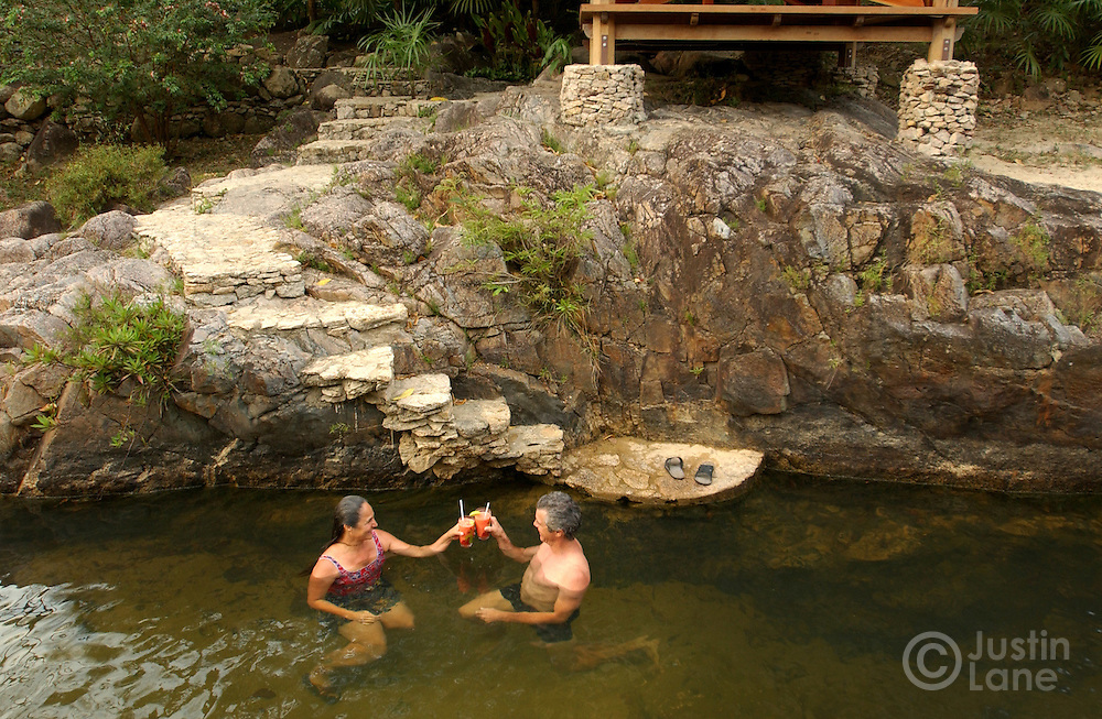 Chris Tompson (R) and Toni Cervantes, of Los Angeles, CA, relax in the river that runs through the Blancaneaux Lodge, of Francis Ford Coppola's resorts, in the eastern part of Belize.<br />JUSTIN LANE FOR THE NEW YORK TIMES