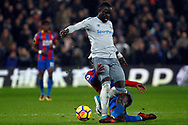 Jeffrey Schlupp of Crystal Palace (R) tackles Idrissa Gueye of Everton (L). Premier League match, Crystal Palace v Everton at Selhurst Park in London on Saturday 18th November 2017.<br /> pic by Steffan Bowen, Andrew Orchard sports photography.