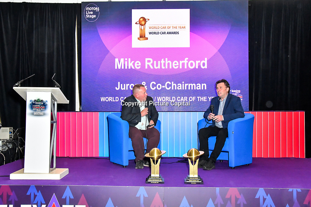 Speaker Mike Rutherford (R) at the London Motor & Tech Show opening day on 16 May 2019, at Excel London, UK.