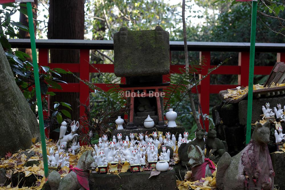 a small ritual altar with fox messenger and gate Kamakura Japan