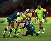 Sale Sharks stand-off AJ McGinty is held by Irish defenders during the The Aviva Premiership match Sale Sharks -V- London Irish  at The AJ Bell Stadium, Salford, Greater Manchester, England on September 15, 2017. (Steve Flynn/Image of Sport)