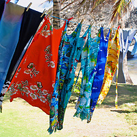 Caribbean wraps hang to dry in the sun of Bathsheba Beach on the east coast of Barbados in the Caribbean.