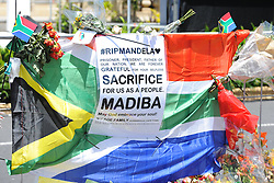 A message attached to a South African flag during a time of national mourning the death of the first democratically elected president, Nelson Mandela, in front of the Cape Town City Hall, South Africa, Saturday, 7th December 2013. Picture by Roger Sedres / i-Images