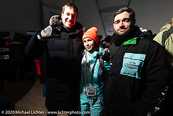 Bike builder Yaroslav Tatarinov, motorcycle riding instructor Oksana Voevodina and car racer Anton Skrypnikov of MostCultCars Auto Museum in Moscow at the Baikal Mile Ice Speed Festival wrap party on the lake. Maksimiha, Siberia, Russia. Saturday, February 29, 2020. Photography ©2020 Michael Lichter.