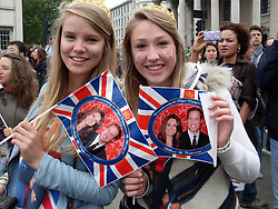 London, UK  29/04/2011. The Royal Wedding of HRH Prince William to Kate Middleton. People enjoying the royal wedding in Trafalgar Sqaure on the big television screen. Photo credit should read Grant Falvey/LNP. Please see special instructions. © under license to London News Pictures