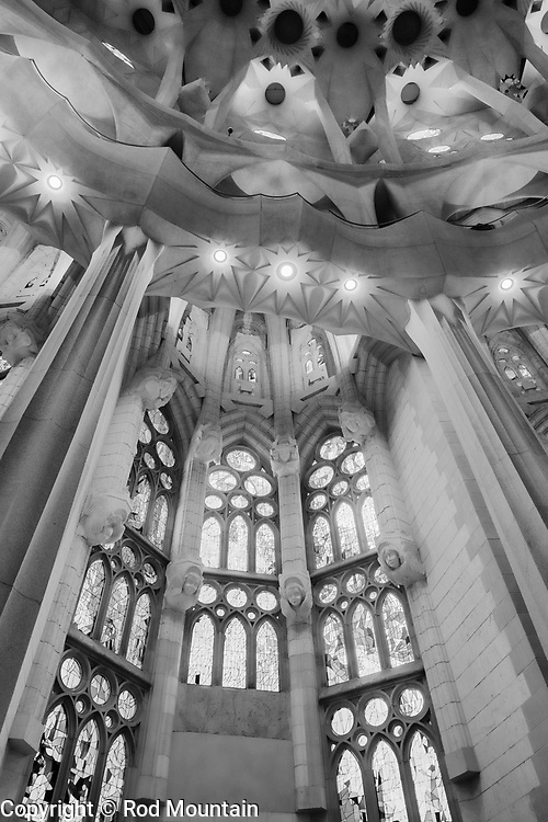 """Barcelona, Spain - February 20, 2018 - Some of the wonderful details inside the Sagrada Familia in Barcelona, Spain. The Temple Explatori de la Sagrada Familia began it's construction in 1882. The structural work and decorations continue to this day. The designer of this amazing UNESCO World Heritage Site is Catalan architect Antoni Gaudi (1852-1926). On the subject of the extremely long construction period, Gaudi once remarked: """"My client is not in a hurry.""""<br /> <br /> Image: © Rod Mountain http://www.rodmountain.com<br /> Nikon D800 / Nikkor Lens<br /> @nikoncanada @NikonUSA @nikoneurope<br /> @spain @barcelona_cat @visitbarcelona @basilicasagradafamilia @catalunyaexperience<br /> <br /> @spain.info @bcn.cat @BasilicadelaSagradaFamilia @visitbarcelona @catalunyaexperience.usa<br /> <br /> @spain @barcelona_cat @sagradafamilia @VisitBCN_EN @catexperience<br /> <br /> https://en.wikipedia.org/wiki/Sagrada_Fam%C3%ADlia<br /> https://sagradafamilia.org<br /> https://www.barcelona.cat/en/<br /> https://www.barcelonaturisme.com/wv3/en/<br /> https://en.wikipedia.org/wiki/Barcelona<br /> https://www.spain.info/en/que-quieres/ciudades-pueblos/grandes-ciudades/barcelona.html<br /> https://www.spain.info/en/<br /> <br /> @OfTheAfternoon @Monochromamagazine @blackandwhitephotog @monovisionsmag<br /> #NikonCA #NikonNoFilter #NikonEurope #icu_architecture #creative_architecture #architeturelovers #architecturephotography #archidaily #architecture #bnw_captures #bnwmood #bnw_planet #blackandwhiteisworththefight #moodygrams #passionpassport #lifeofadventure #mytinyatlas #folkgood #ourplanetdaily #travelphotographer #Spain #TourismSpain #VisitSpain #Barcelona #bnw_barcelona #Faith #passion #Christ #church #culture"""