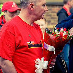People visited Anfield to remember and pay their respects to the 96 who died 19 years ago at Hillsborough.  This woman tied a tshirt to the Shankly Gates.