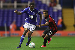 Birmingham City's Wes Harding (left) and AFC Bournemouth's Jordon Ibe battle for the ball during the Carabao Cup, Second Round match at St Andrew's, Birmingham.