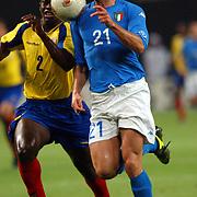 Italy's Christian Vieri outsprints Ecuador's Augusto Poroso to score their second goal