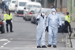 © Licensed to London News Pictures. 21/02/2018. London, UK. Police forensics officers are seen on Bartholomew Road, Camden, where one of two stabbings took place yesterday evening, killing two young men. Police were called to a second disturbance in the area, in which a second man was stabbed to death, and are currently investigating if the two incidents are connected. Photo credit: Peter Macdiarmid/LNP