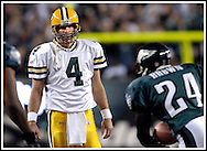 Green Bay's Brett Favre looks at Eagles Sheldon Brown after he intercepted Favre's pass at the Philadelphia's 7-yard line in the 2nd quarter. Brown was already tackled and was running toward his bench. .The Green Bay Packers traveled to Lincoln Financial Field in Philadelphia to play the Eagles Sunday, December 5, 2004. WSJ/Steve Apps.