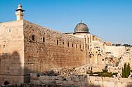 The black dome of the Al Aqsa Mosque rises above Jerusalem's Old City walls