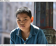 Portrait of a young man on a Seattle street corner.