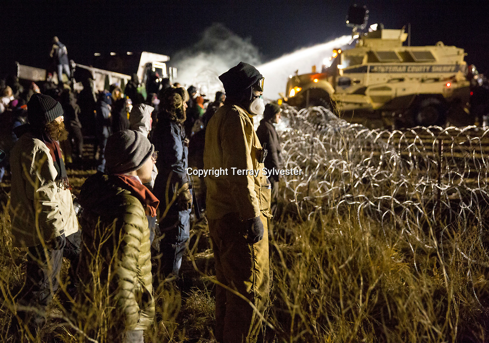 Police use a water cannon to drench opponents of the Dakota Access oil pipeline during a standoff in freezing temperatures on Backwater Bridge near the pipeline route on November 20, 2016. Cannon Ball, North Dakota, United States.