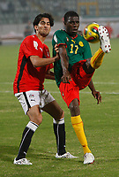 Photo: Steve Bond/Richard Lane Photography.<br /> Egypt v Cameroun. Africa Cup of Nations. 22/01/2008. Mahmoud Fathalla (L) cannot stop Mohamadou Idrissou (R) getting a cross in