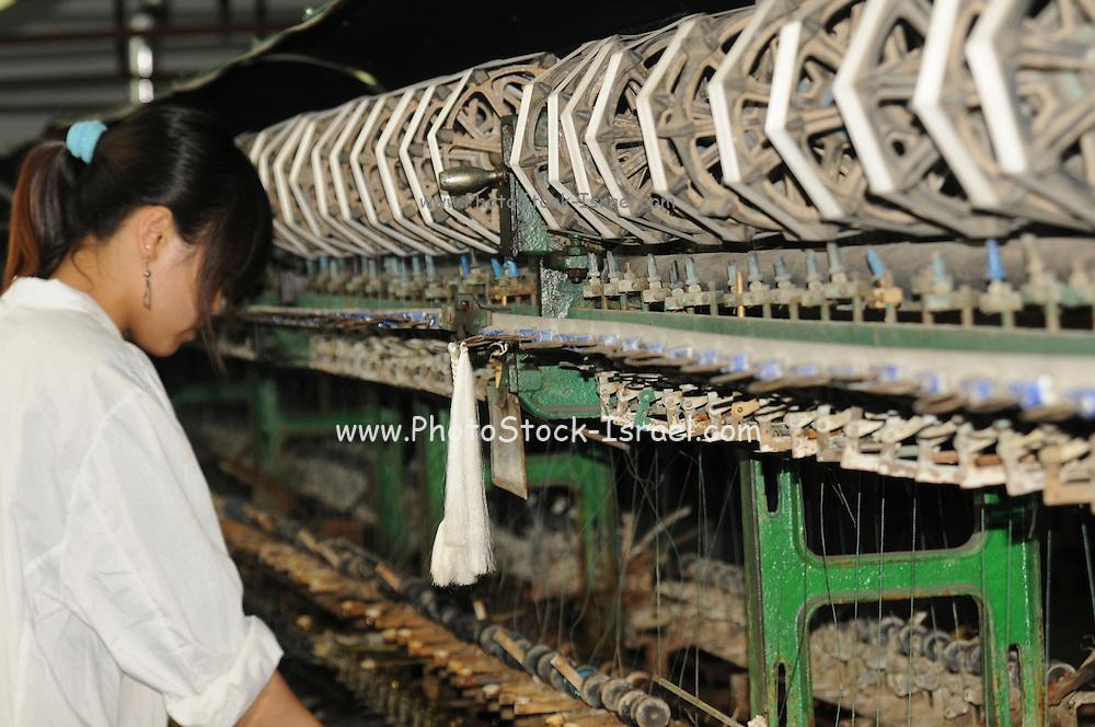 China, Shanghai Silk factory visitor Center spinning the silk fibre