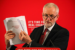 © Licensed to London News Pictures. 21/10/2019. London, UK. Jeremy Corbyn holds up reductive documents that are secret talks between the Government and the US on the NHS. Jeremy Corbyn arrive earlier at Church House, London to announce a major statement on the NHS. Photo credit: Alex Lentati/LNP