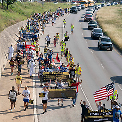 Voting rights  groups march toward the Texas Capitol from north Austin on the third day of a 30-mile journey protesting Republican efforts to suppress votes nationwide and in Texas. Shifts of marchers trade off in an effort to combat oppressive Texas heat.