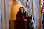 Rechitsy, Russia, 02/03/2008..A voter emerges from a polling booth during the Presidential election that President Vladimir Putin's chosen heir Deputy Prime Minister Dmitry Medvedev is expected to win easily in the first round.