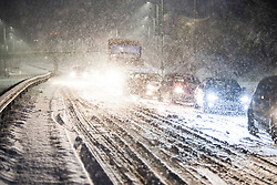 © Licensed to London News Pictures. 10/12/2017. Bourne End, UK. Traffic backed up along the A41 near Bourne End in Buckinghamshire where a car has spun on the road in heavy snowfall, as parts of the south east of England are blanketed with snow for the first time this winter. Photo credit: Ben Cawthra/LNP