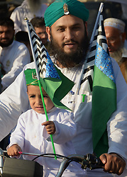 November 21, 2018 - Lahore, Pakistan - Sunni Muslims march in a rally wave green flags during celebrations of Eid-e-Milad-un-Nabi the birth anniversary of Holy Prophet Mohammed in Lahore. (Credit Image: © Rana Sajid Hussain/Pacific Press via ZUMA Wire)