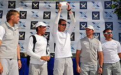 Neugodnikov and his crew collect their prizes for fourth place. Photo:Chris Davies/WMRT