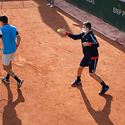 PARIS, FRANCE September 25.  A ball boy and line judge wearing masks as Sebastian Ofer of Austria plays against Jurij Rodionov of Austria in the Qualifications Men's Singles 3rd round match at the 2020 French Open Tennis Tournament at Roland Garros on September 25th 2020 in Paris, France. (Photo by Tim Clayton/Corbis via Getty Images)