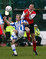 Photo: Scott Heavey<br />Brighton & Hove Albion V Rotherham United. 08/03/03  Nationwide Div 1 <br /><br />Simon Rodger (left) clears from Rotherhams John Mullin