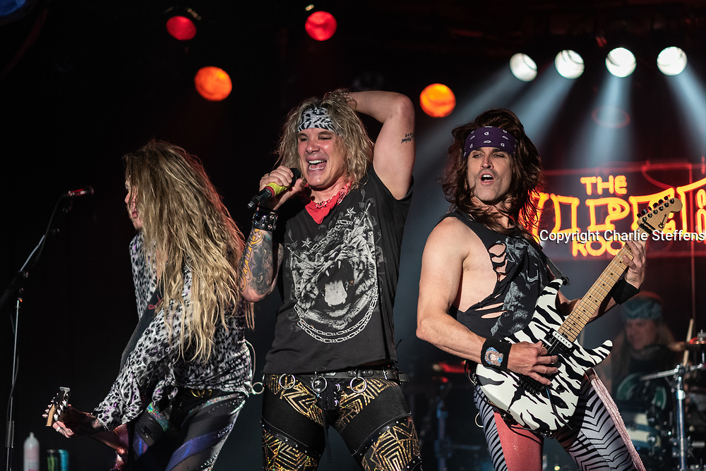 L to R: LEXXI FOXX. MICHAEL STARR, and SATCHEL of Steel Panther at the Viper Room in Los Angeles, California