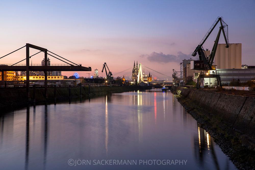Rhine harbor in the district Deutz, in the background the cathedral and Severins bridge, Cologne, Germany.<br /> <br /> Deutzer Hafen am Rhein, im Hintergrund der Dom und Severinsbruecke, Koeln, Deutschland.