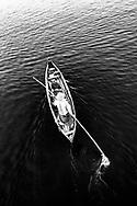 Burmese man on his tiny barge, Taungthaman Lake, Myanmar, Asia